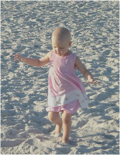 012107-adelaine-bald-head-cancer-child-walking-on-beach