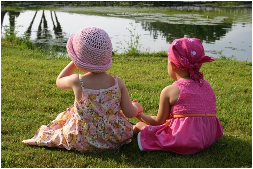 adelaine-and-peyton-two-cancer-girls-sitting-by-the-lake-holding-hands-may-13-2007